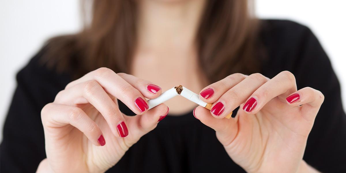 Girl breaking a cigarette in half